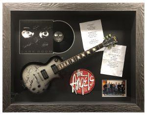 Framed-Guitar-and-Memorabilia